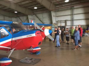 People Viewing a Vintage Plane at Wings Over Miami Museum in Miami Florida
