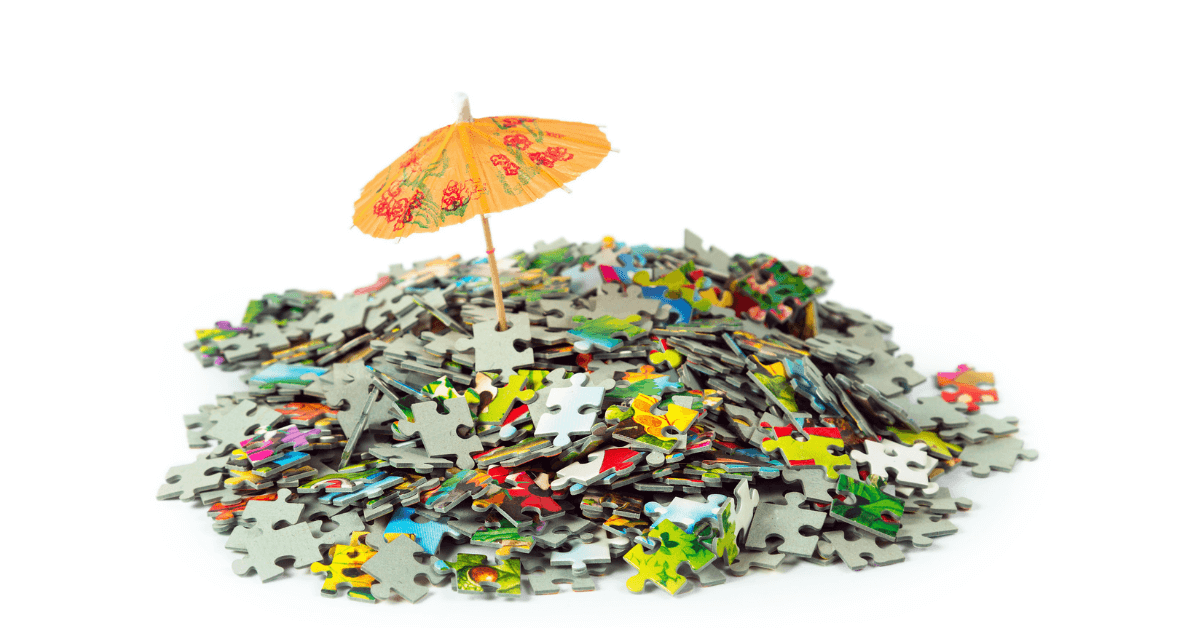 Photo of pile of puzzle pieces with an umbrella